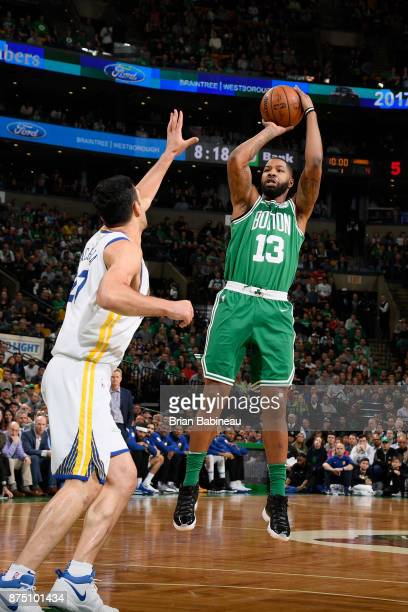Marcus Morris of the Boston Celtics shoots the ball against the Golden State Warriors on November 16 2017 at the TD Garden in Boston Massachusetts...