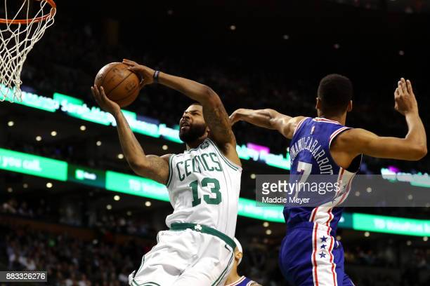 Marcus Morris of the Boston Celtics takes a shot against Timothe LuwawuCabarrot of the Philadelphia 76ers during the second quarter at TD Garden on...