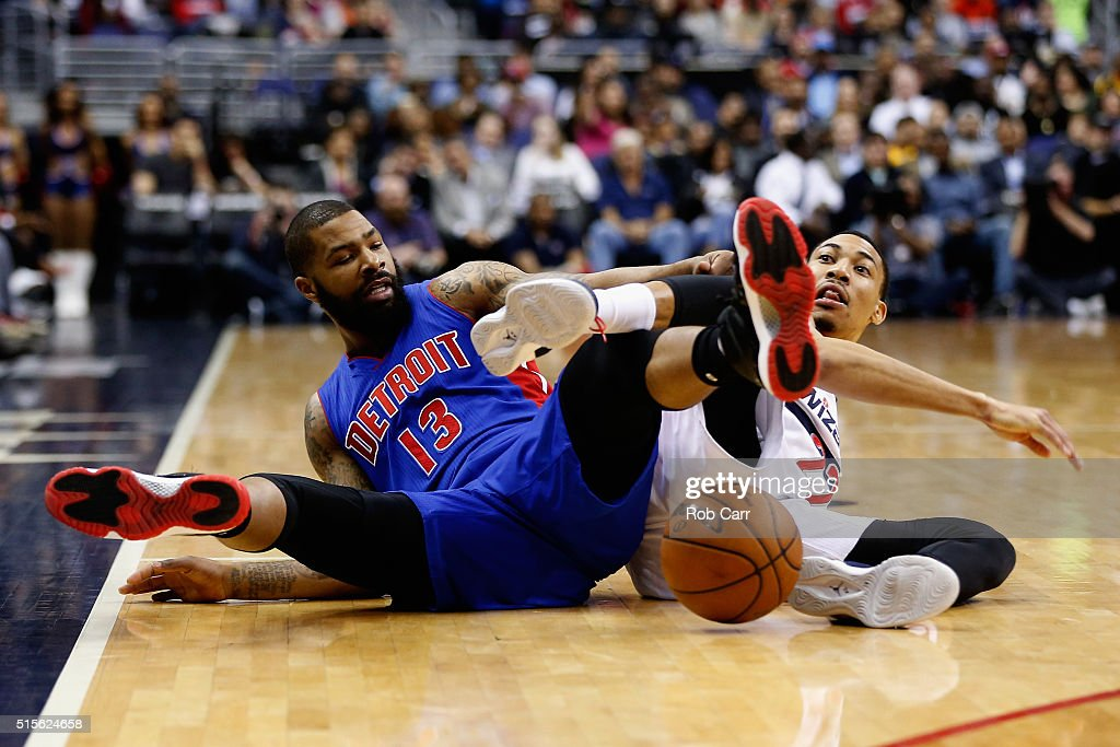 Marcus Morris #13 of the Detroit Pistons and Otto Porter Jr. #22 of the Washington Wizards go after a loose ball in the first half at Verizon Center on March 14, 2016 in Washington, DC.