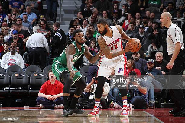 Marcus Morris of the Detroit Pistons handles the ball against Jae Crowder of the Boston Celtics on December 26 2015 at The Palace of Auburn Hills in...