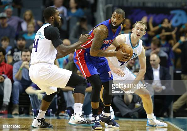 Marcus Morris of the Detroit Pistons is trapped by teammates Michael KiddGilchrist and Cody Zeller of the Charlotte Hornets during their game at...