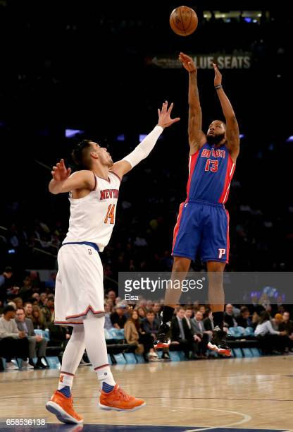 Marcus Morris of the Detroit Pistons takes a shot as Willy Hernangomez of the New York Knicks defends at Madison Square Garden on March 27 2017 in...