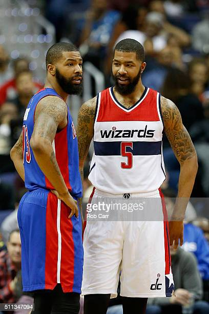 Marcus Morris of the Detroit Pistons talks with his twin brother Markieff Morris of the Washington Wizards in the second half at Verizon Center on...