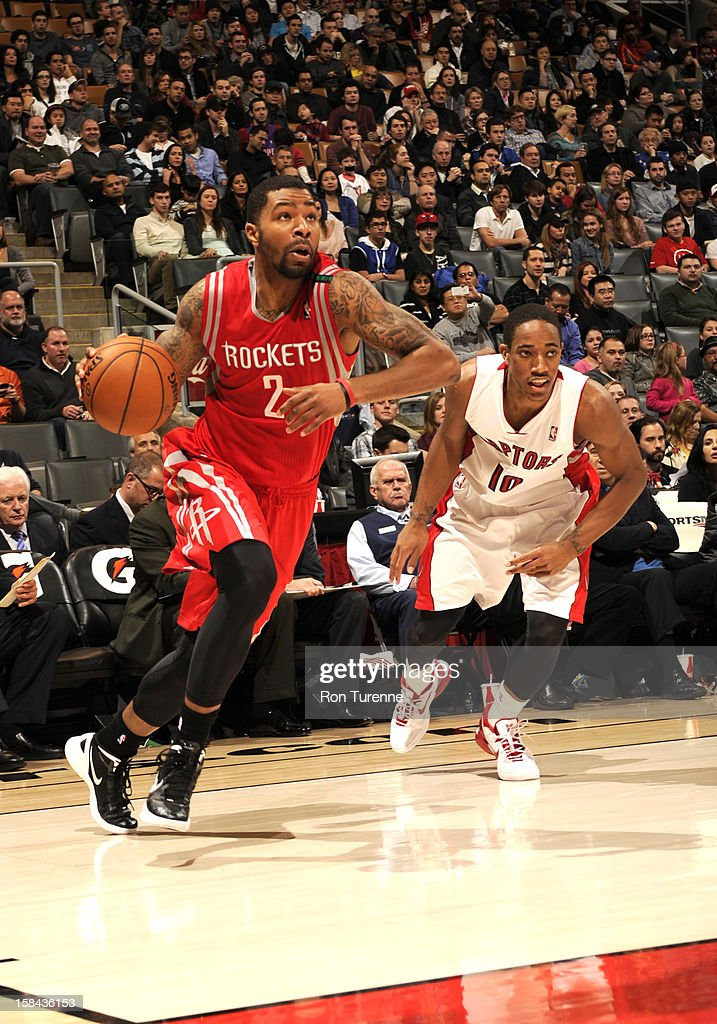 Marcus Morris #2 of the Houston Rockets drives against DeMar DeRozan #10 of the Toronto Raptors during the game between the Toronto Raptors and the Houston Rockets December 16, 2012 at the Air Canada Centre in Toronto, Ontario, Canada.