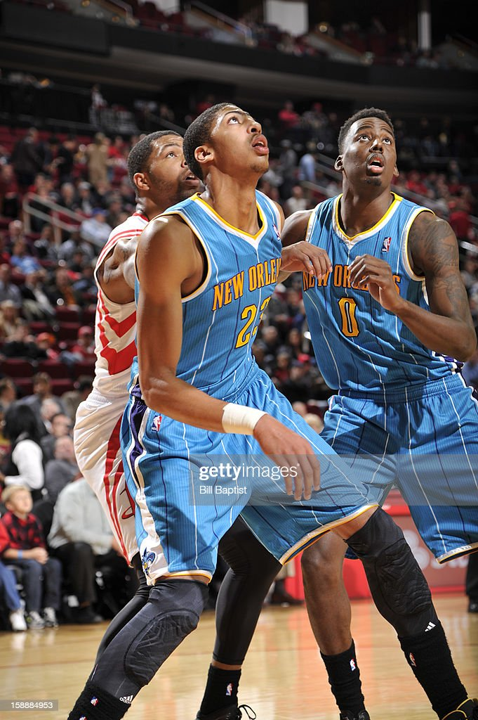 Marcus Morris of the Houston Rockets guards Anthony Davis and AlFarouq Aminu of the New Orleans Hornets battle for the rebound on January 2 2013 at...