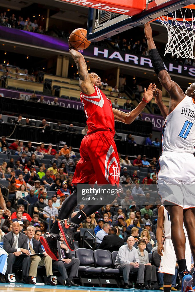 Marcus Morris #2 of the Houston Rockets rises for a dunk against Bismack Biyombo #0 of the Charlotte Bobcats at the Time Warner Cable Arena on January 21, 2013 in Charlotte, North Carolina.