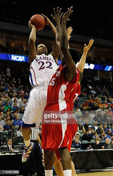 Marcus Morris of the Kansas Jayhawks goes up for a shot against the Boston University Terriers during the second round of the 2011 NCAA men's...