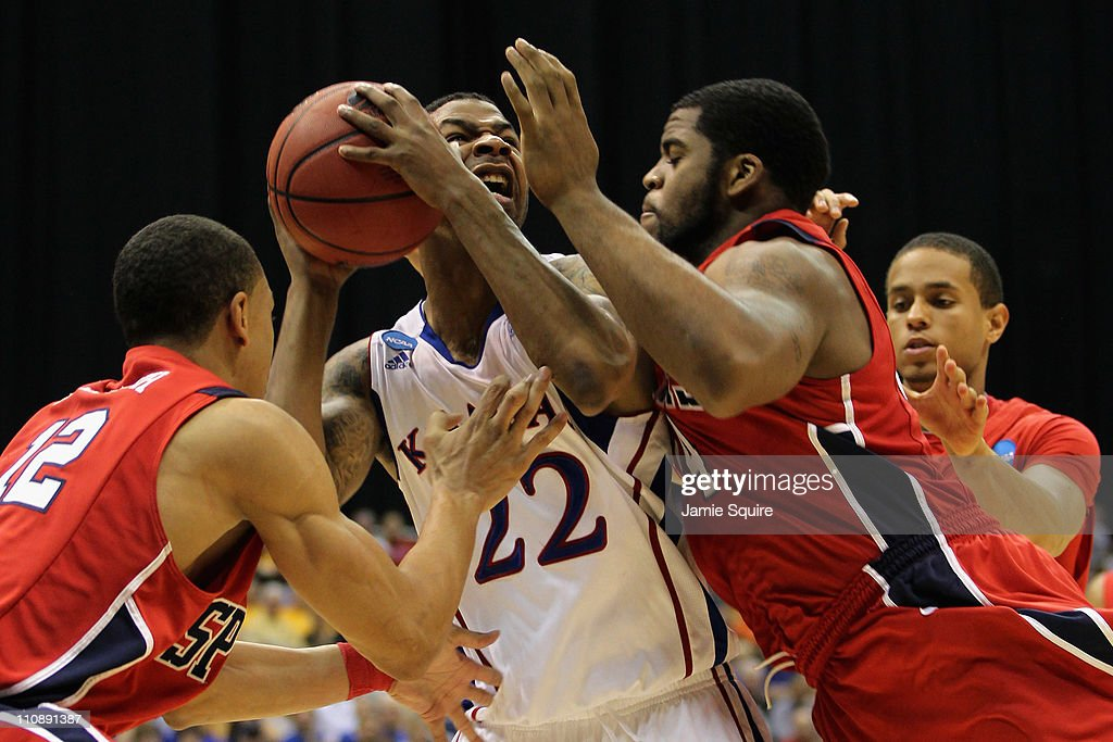 Marcus Morris #22 of the Kansas Jayhawks looks for the shot under pressure against the Richmond Spiders during the southwest regional of the 2011 NCAA men's basketball tournament at the Alamodome on March 25, 2011 in San Antonio, Texas.