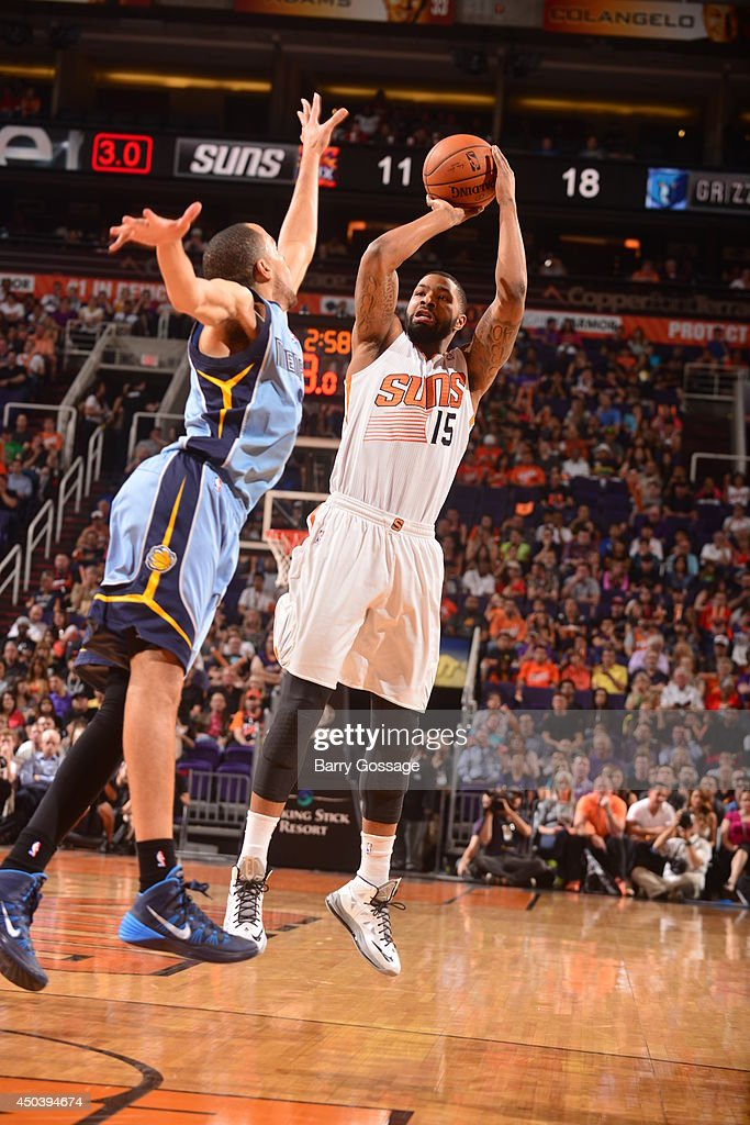 Marcus Morris #15 of the Pheonix Suns shoots against the Memphis Grizzlies on April 14, 2014 at U.S. Airways Center in Phoenix, Arizona.