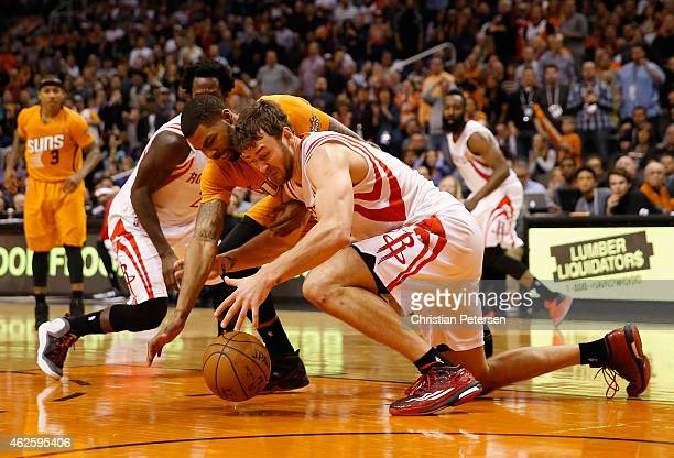 Marcus Morris of the Phoenix Suns and Donatas Motiejunas of the Houston Rockets reach for a loose ball during the second half of the NBA game at US...