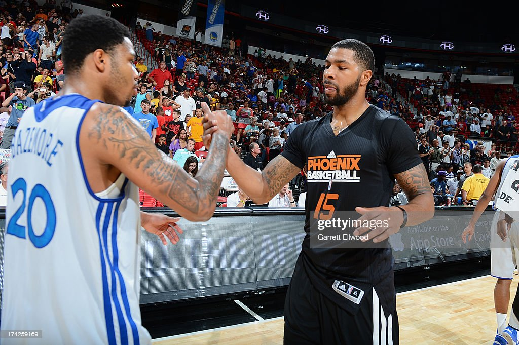 Marcus Morris #15 of the Phoenix Suns congratulates Kent Bazemore #20 of the Golden State Warriors after NBA Summer League Championship Game on July 22, 2013 at the Cox Pavilion in Las Vegas, Nevada.