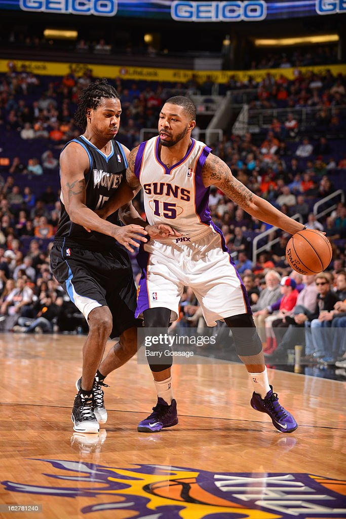 Marcus Morris #15 of the Phoenix Suns drives against Mickael Gelabale #15 of the Minnesota Timberwolves on February 26, 2013 at U.S. Airways Center in Phoenix, Arizona.