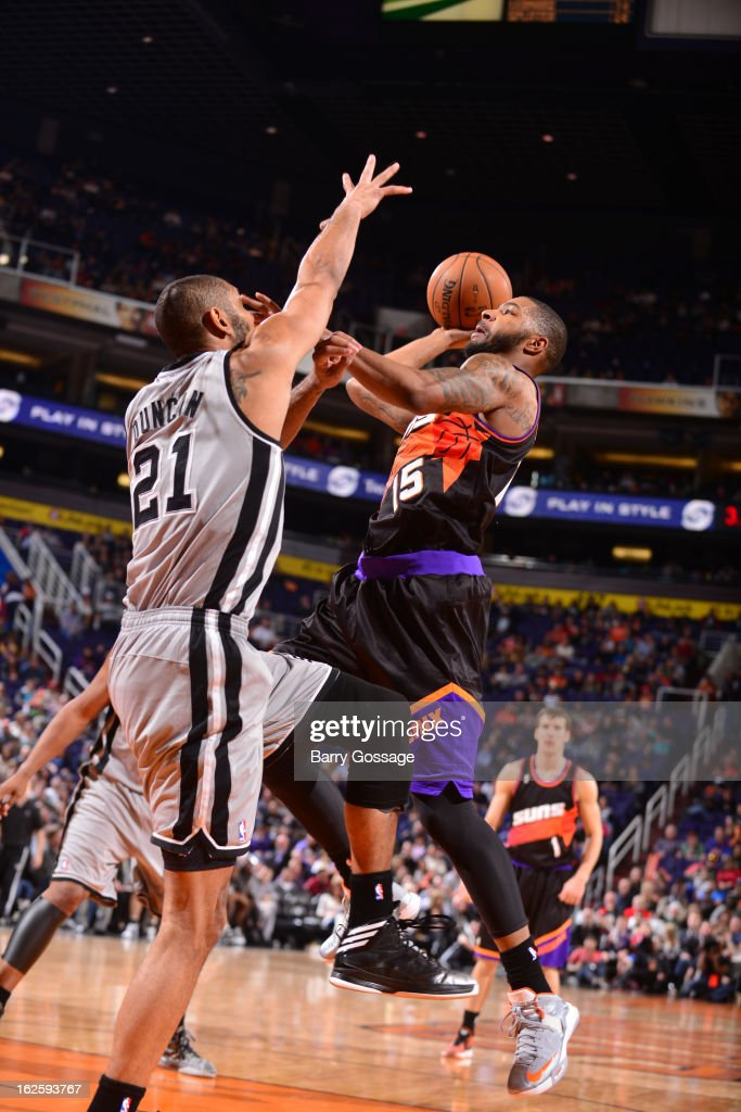 Marcus Morris #15 of the Phoenix Suns drives for a shot against <a gi-track='captionPersonalityLinkClicked' href=/galleries/search?phrase=Tim+Duncan&family=editorial&specificpeople=201467 ng-click='$event.stopPropagation()'>Tim Duncan</a> #21 of the San Antonio Spurs on February 24, 2013 at U.S. Airways Center in Phoenix, Arizona.