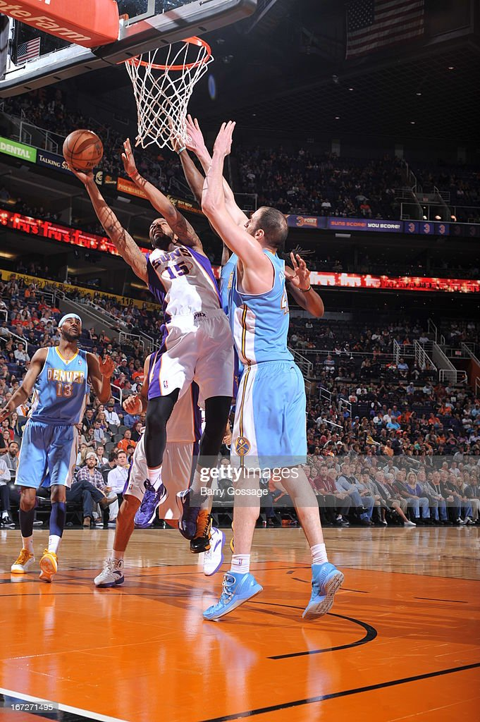 Marcus Morris #15 of the Phoenix Suns drives to the basket against the Denver Nuggets on March 11, 2013 at U.S. Airways Center in Phoenix, Arizona.
