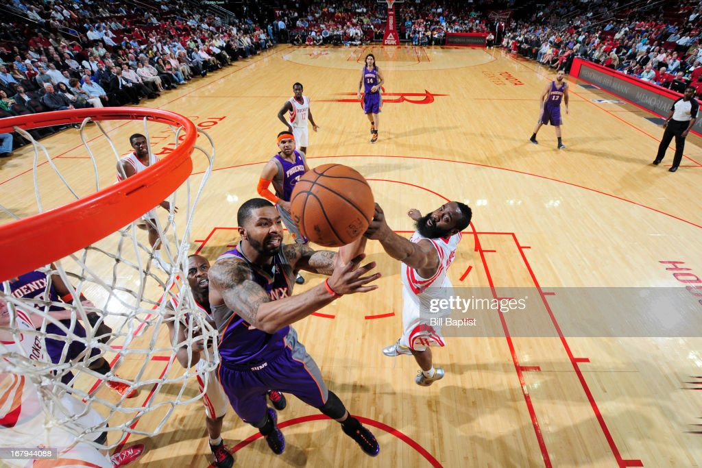 Marcus Morris #15 of the Phoenix Suns grabs a rebound against <a gi-track='captionPersonalityLinkClicked' href=/galleries/search?phrase=James+Harden&family=editorial&specificpeople=4215938 ng-click='$event.stopPropagation()'>James Harden</a> #13 of the Houston Rockets on April 9, 2013 at the Toyota Center in Houston, Texas.