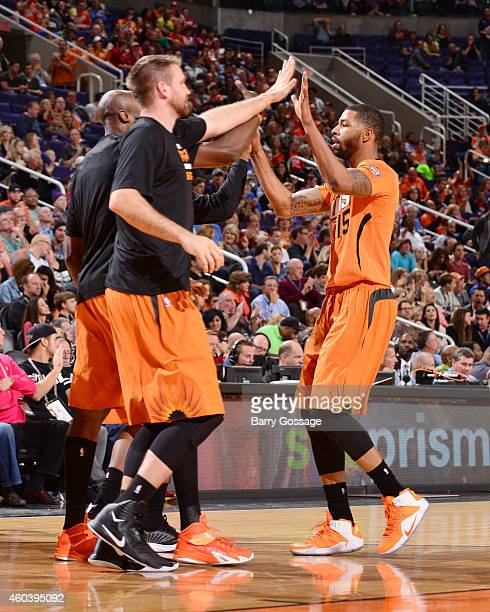 Marcus Morris of the Phoenix Suns high fives teammates during the game against the Detroit Pistons on December 12 2014 at US Airways Center in...