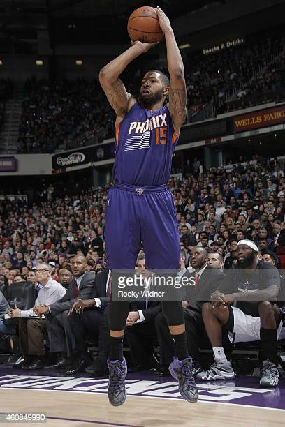 Marcus Morris of the Phoenix Suns shoots against the Sacramento Kings on December 26 2014 at Sleep Train Arena in Sacramento California NOTE TO USER...