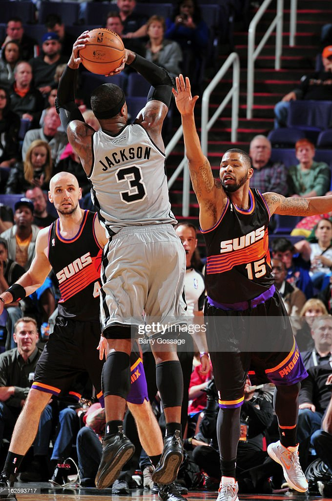Marcus Morris #15 of the Phoenix Suns tries to block the shot of Stephen Jackson #3 of the San Antonio Spurs on February 24, 2013 at U.S. Airways Center in Phoenix, Arizona.