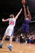 Marcus Morris of the Phoenix Sunsp shoots against Kyle Singler of the Detroit Pistons on January 11 2014 at The Palace of Auburn Hills in Auburn...