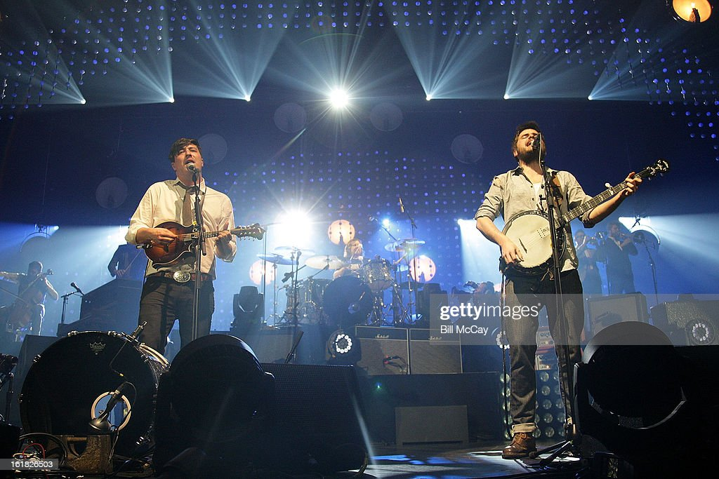 <a gi-track='captionPersonalityLinkClicked' href=/galleries/search?phrase=Marcus+Mumford&family=editorial&specificpeople=5385533 ng-click='$event.stopPropagation()'>Marcus Mumford</a> and <a gi-track='captionPersonalityLinkClicked' href=/galleries/search?phrase=Winston+Marshall&family=editorial&specificpeople=3124664 ng-click='$event.stopPropagation()'>Winston Marshall</a> of Mumford And Sons perform at the Susquehanna Bank Center February 16, 2013 in Camden, New Jersey.
