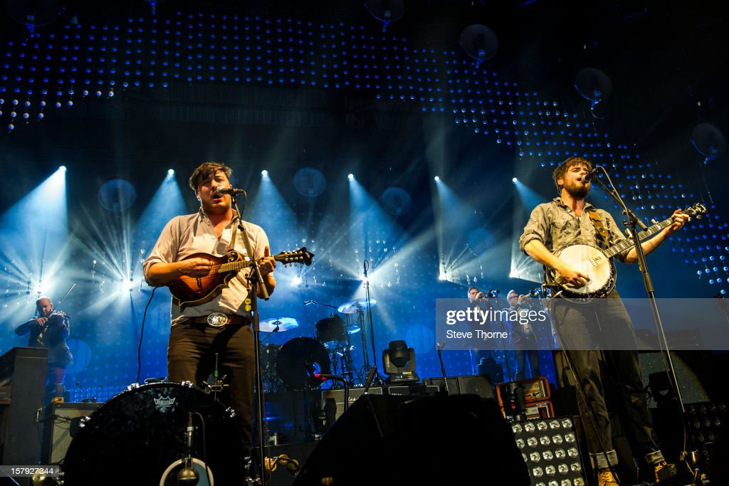 Marcus Mumford and Winston Marshall of Mumford Sons perform at LG Arena on December 7 2012 in Birmingham England