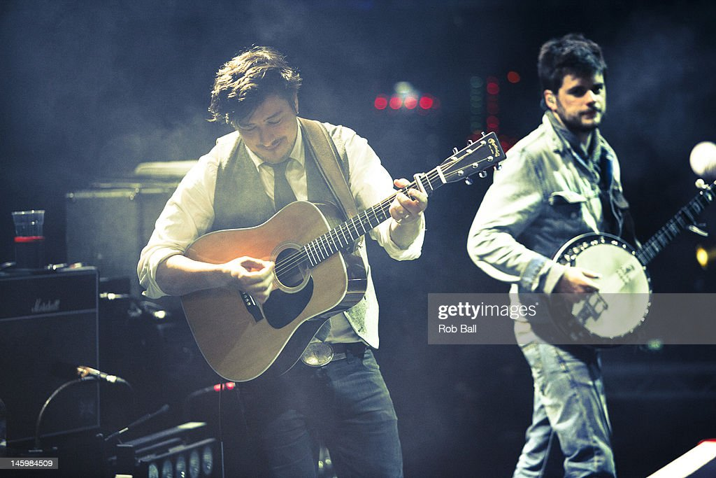 <a gi-track='captionPersonalityLinkClicked' href=/galleries/search?phrase=Marcus+Mumford&family=editorial&specificpeople=5385533 ng-click='$event.stopPropagation()'>Marcus Mumford</a> and <a gi-track='captionPersonalityLinkClicked' href=/galleries/search?phrase=Winston+Marshall&family=editorial&specificpeople=3124664 ng-click='$event.stopPropagation()'>Winston Marshall</a> perform with Mumford and Sons at RockNess festival at Village Of Dores on June 8, 2012 in Inverness, Scotland.