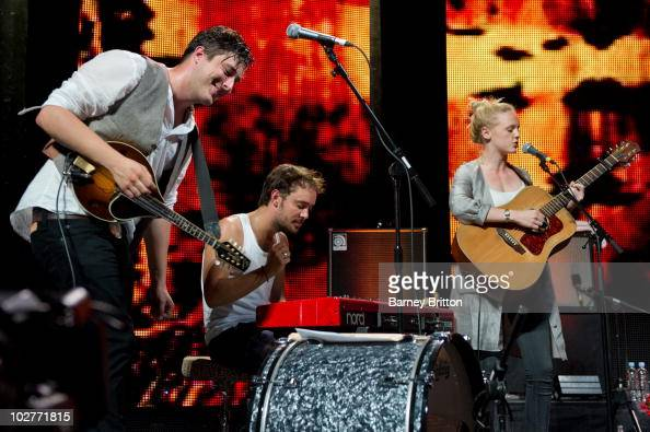 Marcus Mumford Ben Lovett and Laura Marling perform on stage during the iTunes Festival at The Roundhouse on July 9 2010 in London England