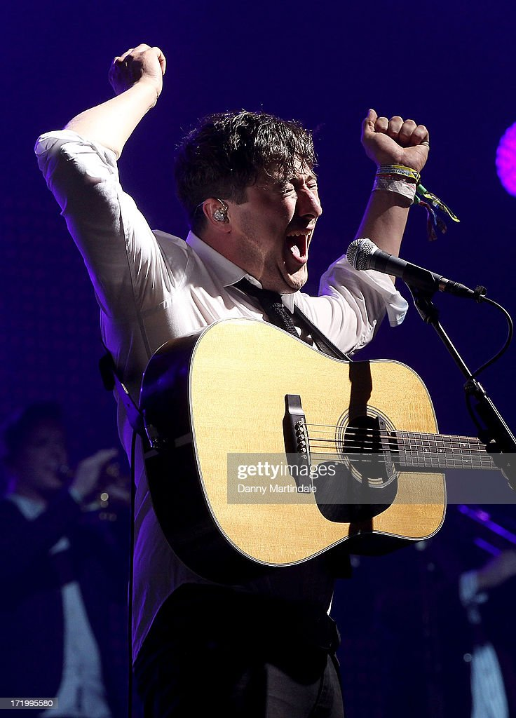 <a gi-track='captionPersonalityLinkClicked' href=/galleries/search?phrase=Marcus+Mumford&family=editorial&specificpeople=5385533 ng-click='$event.stopPropagation()'>Marcus Mumford</a> from the Mumford and Sons performs at day 4 of the 2013 Glastonbury Festival at Worthy Farm on June 30, 2013 in Glastonbury, England.