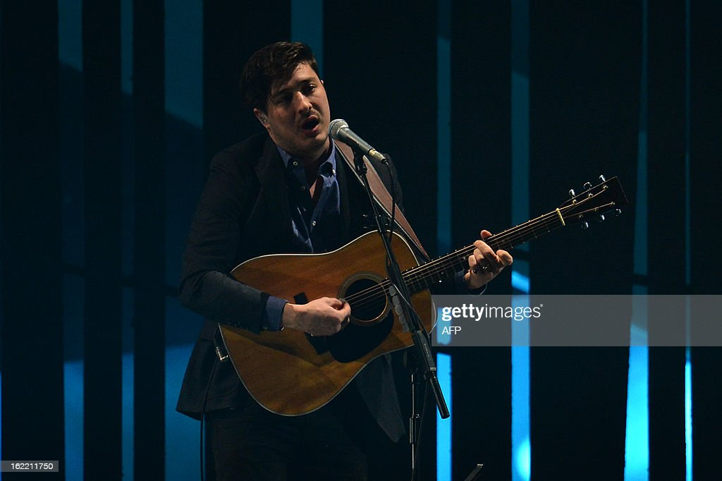 Marcus Mumford of British folk rock band 'Mumford and Sons' performs on stage at the BRIT Awards 2013 in London on February 20, 2013.