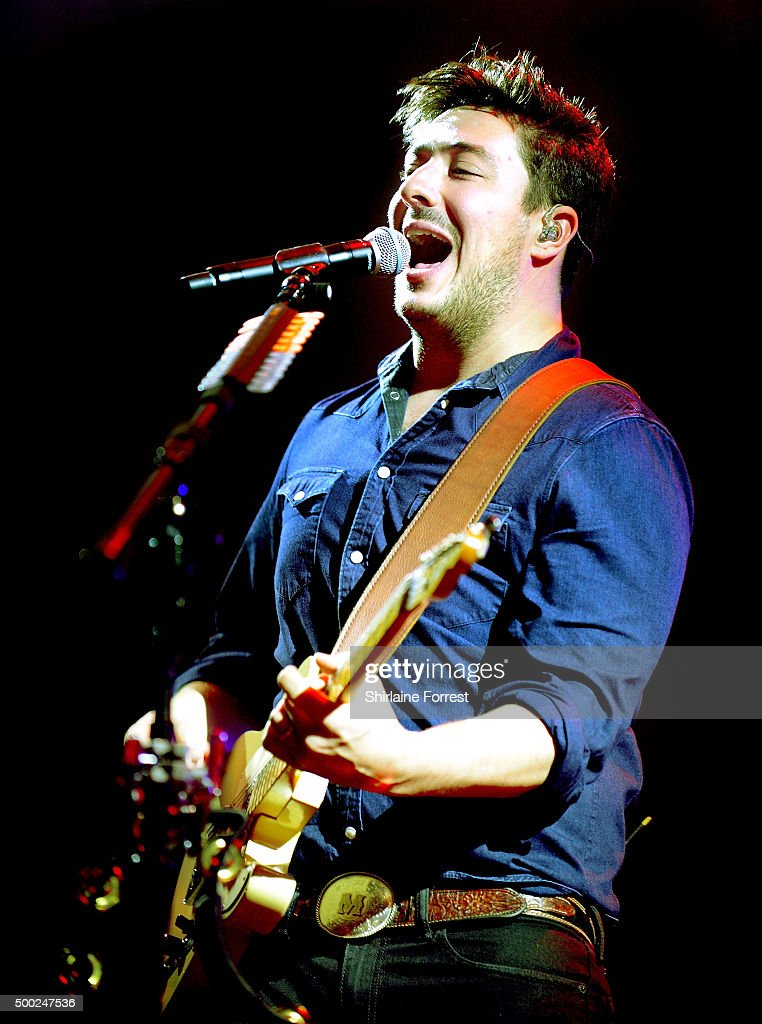 Marcus Mumford of Mumford and Sons performs at Manchester Arena on December 6 2015 in Manchester England