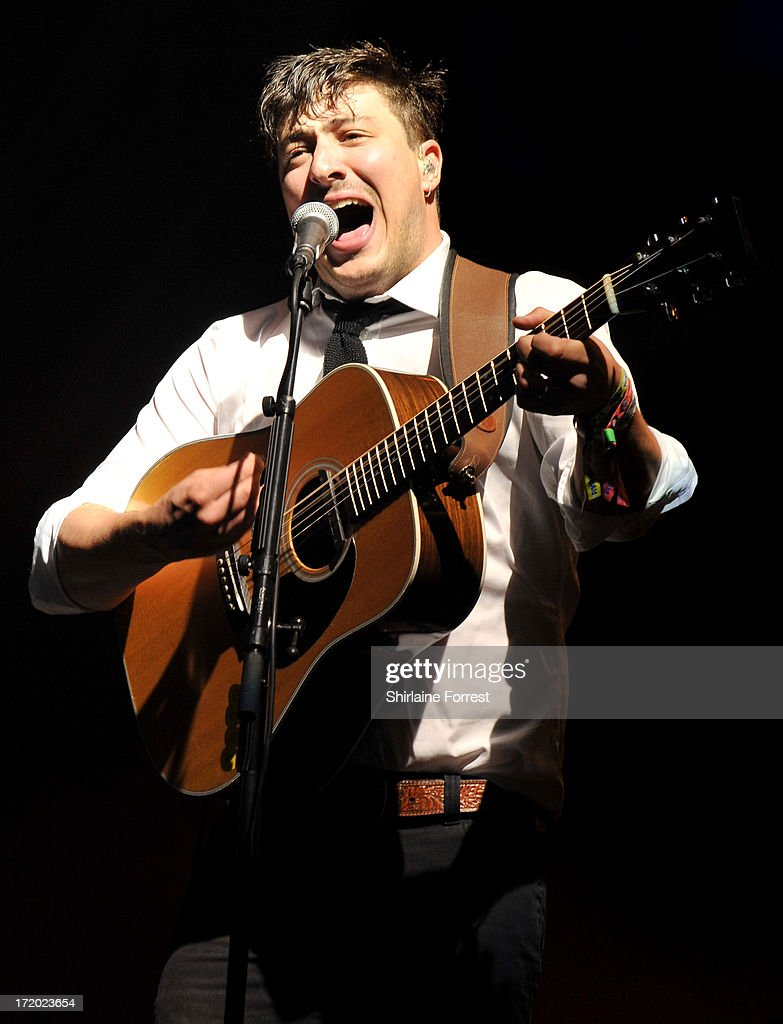 <a gi-track='captionPersonalityLinkClicked' href=/galleries/search?phrase=Marcus+Mumford&family=editorial&specificpeople=5385533 ng-click='$event.stopPropagation()'>Marcus Mumford</a> of Mumford and Sons performs headlining the Pyramid Stage at day 4 of the 2013 Glastonbury Festival at Worthy Farm on June 30, 2013 in Glastonbury, England.