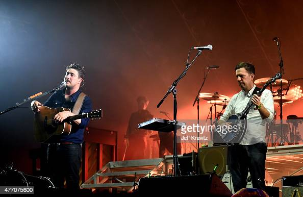 Marcus Mumford of Mumford Sons and actor Ed Helms perform onstage at What Stage during Day 3 of the 2015 Bonnaroo Music And Arts Festival on June 13...