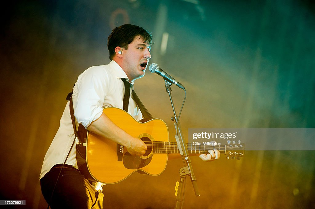 Marcus Mumford of Mumford & Sons performs at their biggest headline show to date during the Summer Stampede tour at Olympic Park on July 6, 2013 in London, England.