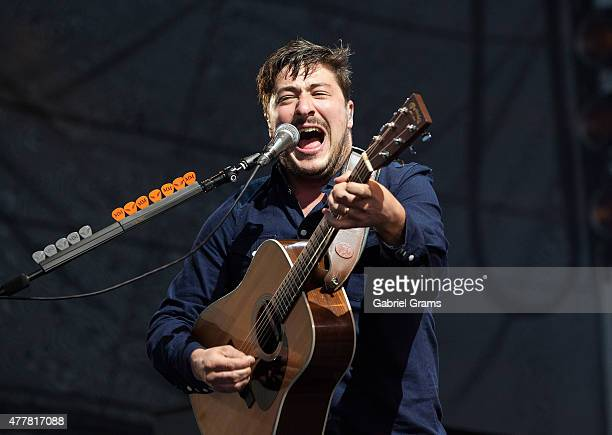 Marcus Mumford of Mumford Sons performs during their Gentlemen on the Road Tour at Montrose Beach on June 19 2015 in Chicago Illinois