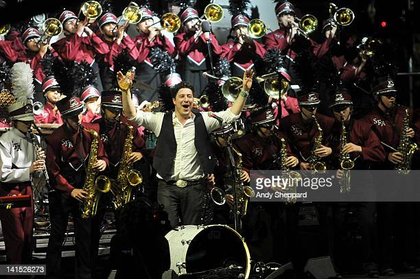 Marcus Mumford of Mumford Sons performs on stage with members of the Austin High School Marching Band at LBJ Lawn University of Texas presented by...