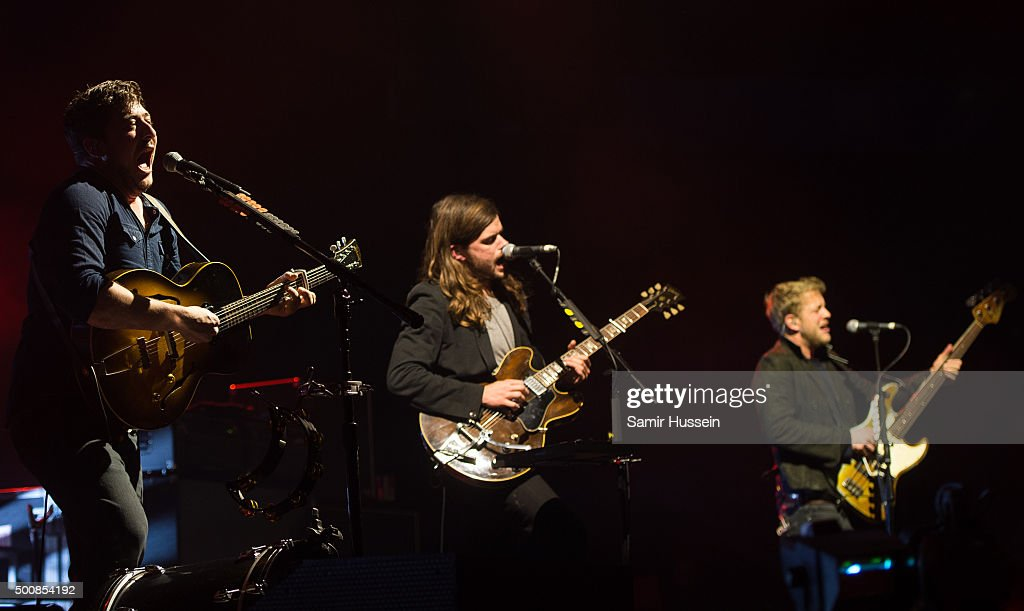 Marcus Mumford Winston Marshall and Ted Dwane of Mumford Sons performs live on stage at The O2 Arena on December 10 2015 in London England