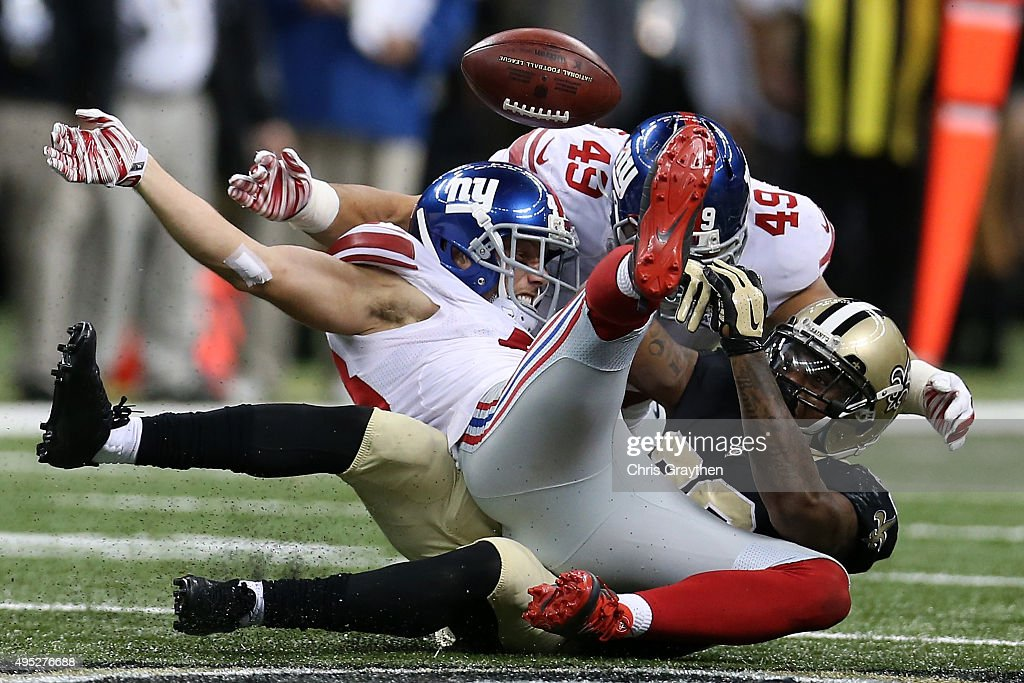 Marcus Murphy #23 of the New Orleans Saints has the ball stripped by New York Giants defensive back Craig Dahl #43 at Mercedes-Benz Superdome on November 1, 2015 in New Orleans, Louisiana.