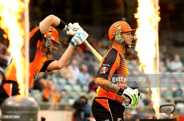 Marcus North and Herschelle Gibbs of the Scorchers walk out to bat during the Big Bash League match between the Perth Scorchers and the Melbourne...