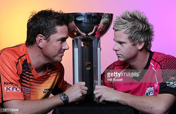 Marcus North of the Perth Scorchers poses with Steve Smith of the Sydney Sixers and the T20 trophy during the Big Bash League Final press conference...
