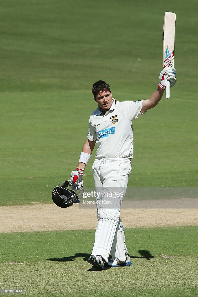 <a gi-track='captionPersonalityLinkClicked' href=/galleries/search?phrase=Marcus+North&family=editorial&specificpeople=167183 ng-click='$event.stopPropagation()'>Marcus North</a> of the Warriors celebrates reaching 100 runs during day one of the Sheffield Shield match between the Redbacks and the Warriors at Adelaide Oval on November 13, 2013 in Adelaide, Australia.