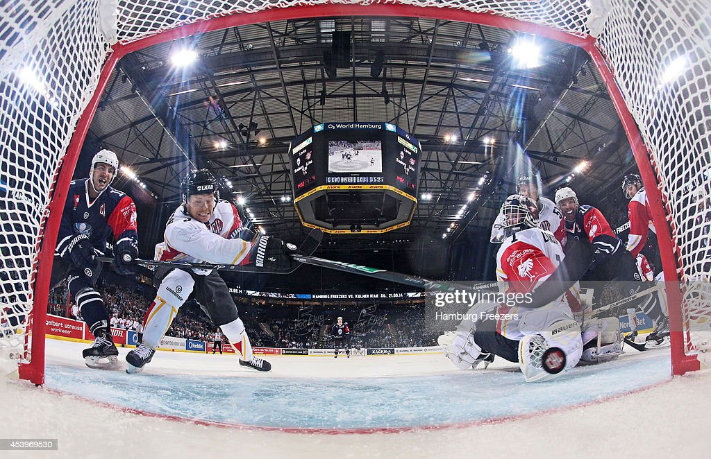 Marcus Oskarsson #03 of Lulea (L) saves a goal during the Champions Hockey League group stage game between Hamburg Freezers and Lulea Hockey on August 22, 2014 in Hamburg, Germany.