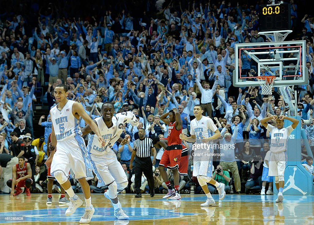 Marcus Paige and the North Carolina Tar Heels celebrate after a win against the Louisville Cardinals at the Dean Smith Center on January 10 2015 in...
