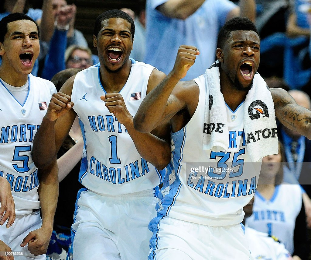 Marcus Paige #5, Dexter Strickland #1 and Reggie Bullock #35 of the North Carolina Tar Heels cheer for the reserves during a win over the Wake Forest Demon Deacons at the Dean Smith Center on February 5, 2013 in Chapel Hill, North Carolina. North Carolina won 87-62.