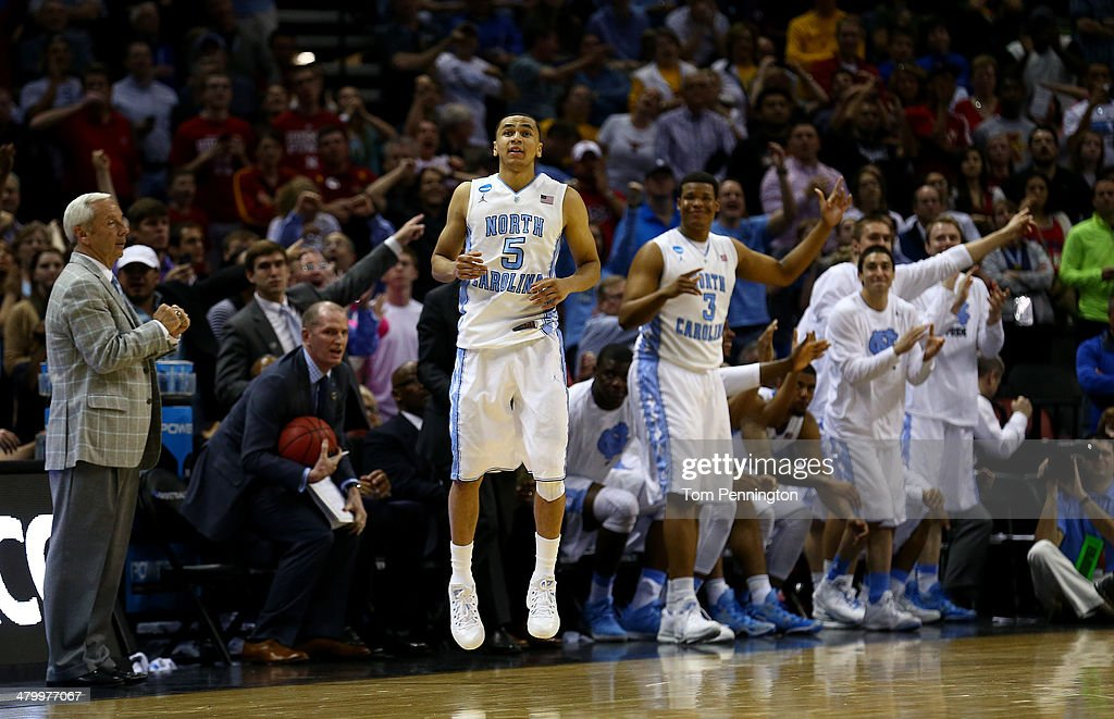 <a gi-track='captionPersonalityLinkClicked' href=/galleries/search?phrase=Marcus+Paige&family=editorial&specificpeople=7880805 ng-click='$event.stopPropagation()'>Marcus Paige</a> #5 of the North Carolina Tar Heels celebrates during the closing seconds of the Tar Heels 79-77 win over the Providence Friars during the second round of the 2014 NCAA Men's Basketball Tournament at AT&T Center on March 21, 2014 in San Antonio, Texas.
