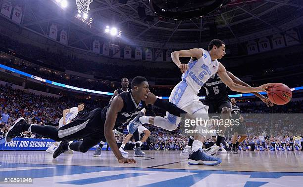 Marcus Paige of the North Carolina Tar Heels controls the ball against Kris Dunn of the Providence Friars who lunges for the ball in the second half...