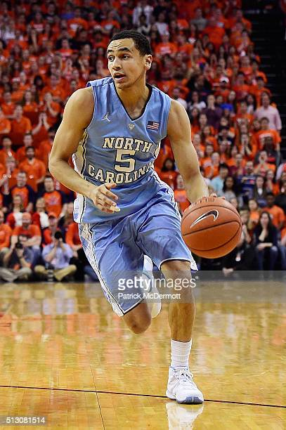 Marcus Paige of the North Carolina Tar Heels dribbles the ball in first half during their game against the Virginia Cavaliers at John Paul Jones...