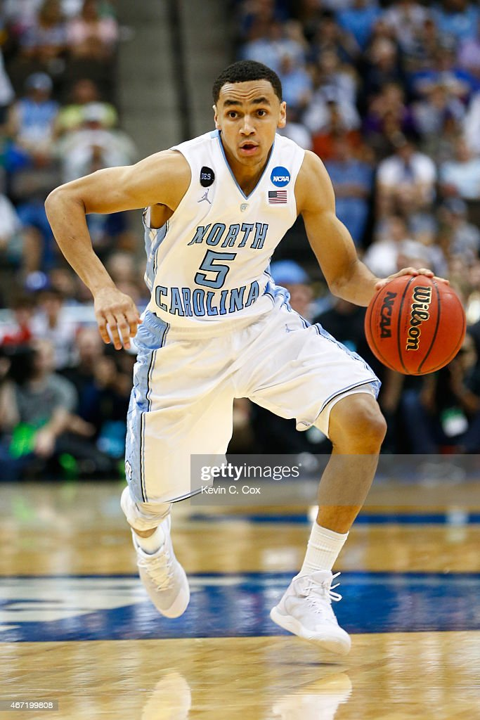 Marcus Paige of the North Carolina Tar Heels dribbles up the court against the Arkansas Razorbacks in the second half during the third round of the...