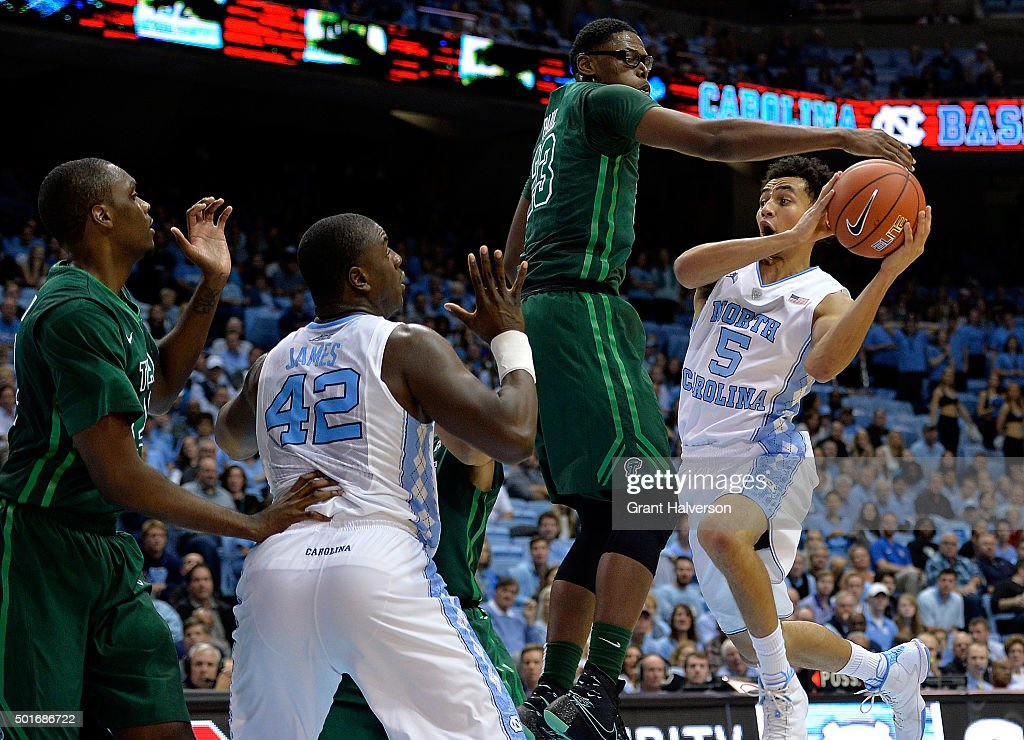 Marcus Paige of the North Carolina Tar Heels drives against Paul Blake of the Tulane Green Wave during their game at the Dean Smith Center on...