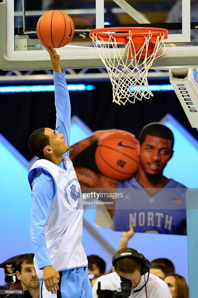 <a gi-track='captionPersonalityLinkClicked' href=/galleries/search?phrase=Marcus+Paige&family=editorial&specificpeople=7880805 ng-click='$event.stopPropagation()'>Marcus Paige</a> #5 of the North Carolina Tar Heels drives for a layup during Late Night with Roy Williams at the Dean Smith Center on October 25, 2013 in Chapel Hill, North Carolina.