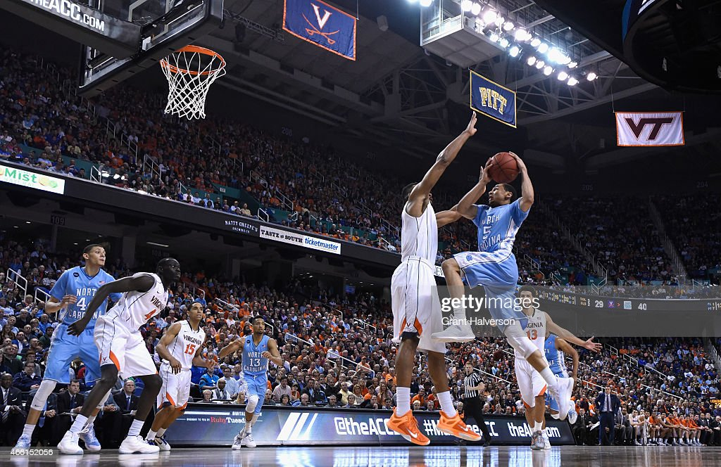 <a gi-track='captionPersonalityLinkClicked' href=/galleries/search?phrase=Marcus+Paige&family=editorial&specificpeople=7880805 ng-click='$event.stopPropagation()'>Marcus Paige</a> #5 of the North Carolina Tar Heels drives to the basket against the Virginia Cavaliers during the semifinals of the 2015 ACC Basketball Tournament at Greensboro Coliseum on March 13, 2015 in Greensboro, North Carolina.
